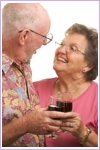 Senior couple enjoying a glass of wine